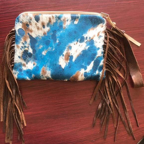 Handbags - Reversible acid wash cowhide fringe clutch